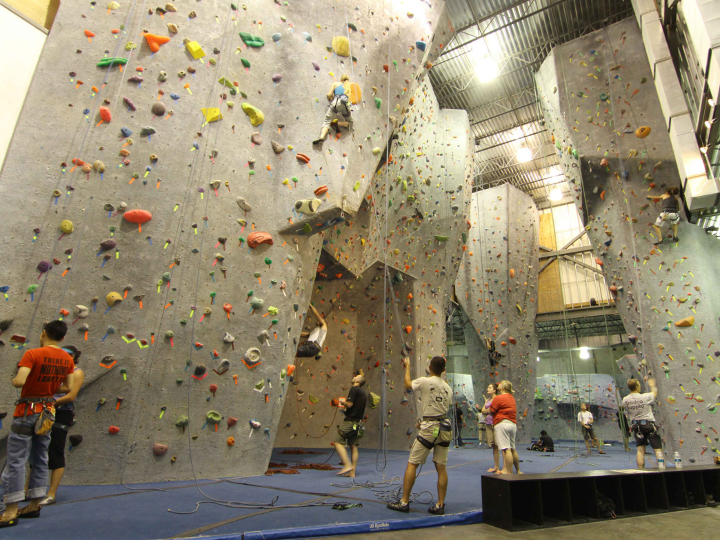 Each of the main climbing walls at Sportrock have several routes, marked by colored holds. Photo: