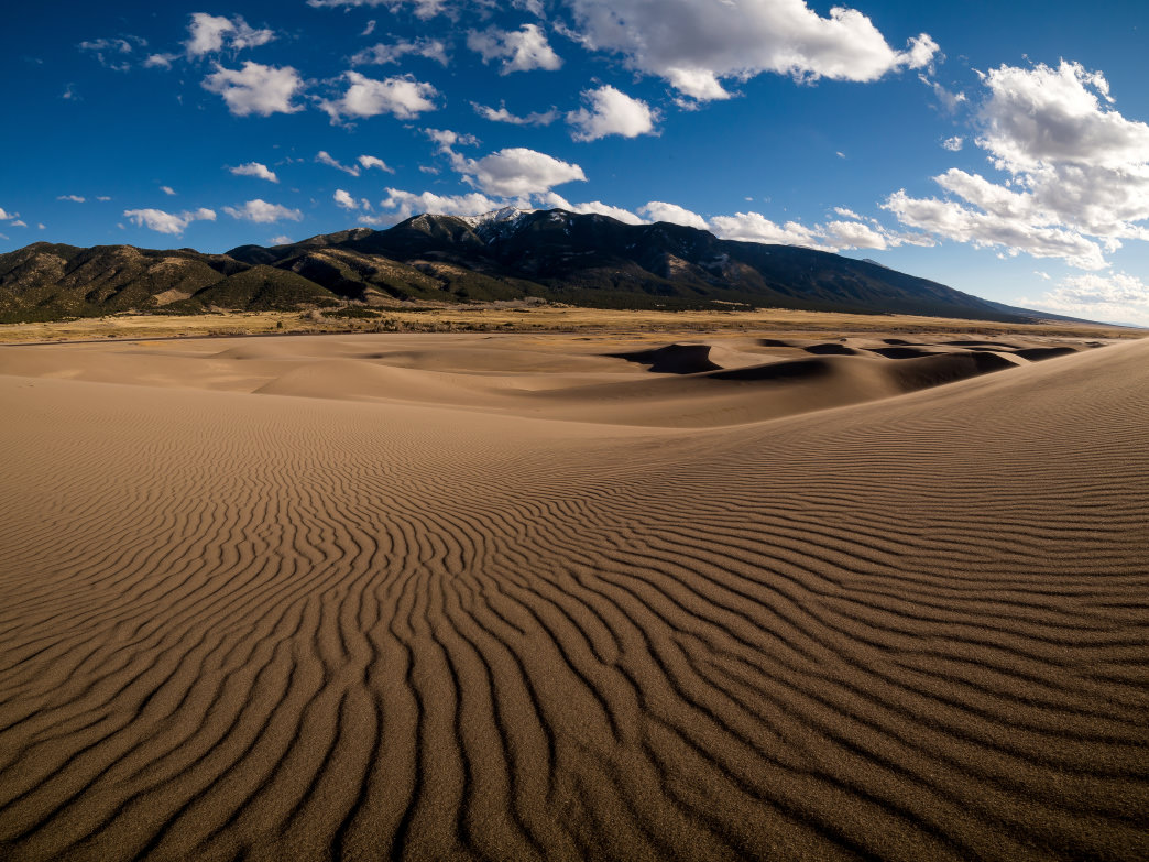 Great Sand Dunes National Park is a short drive from Alamosa, where you can enjoy an Alamosa Amber at the San Luis Valley Brewing Company.