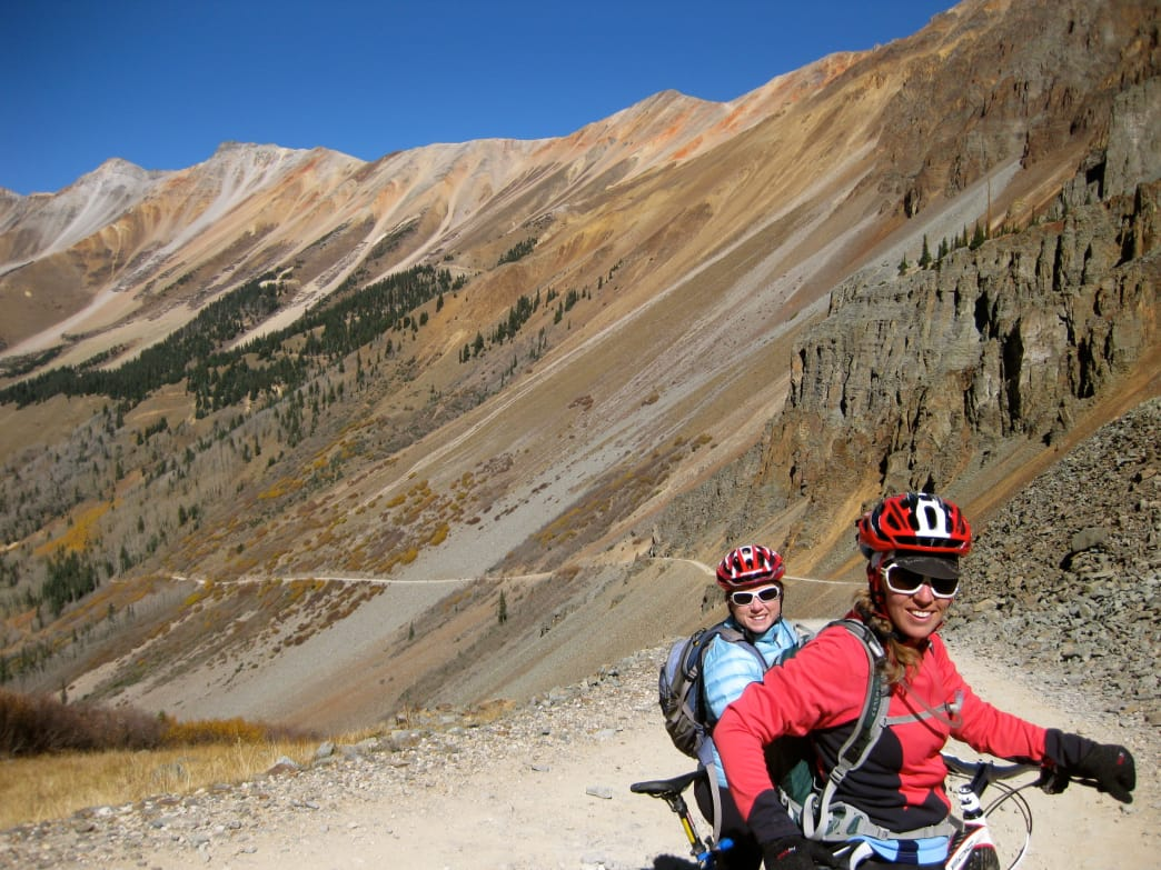 Riders begin the descent after reaching the top of Ophir Pass.