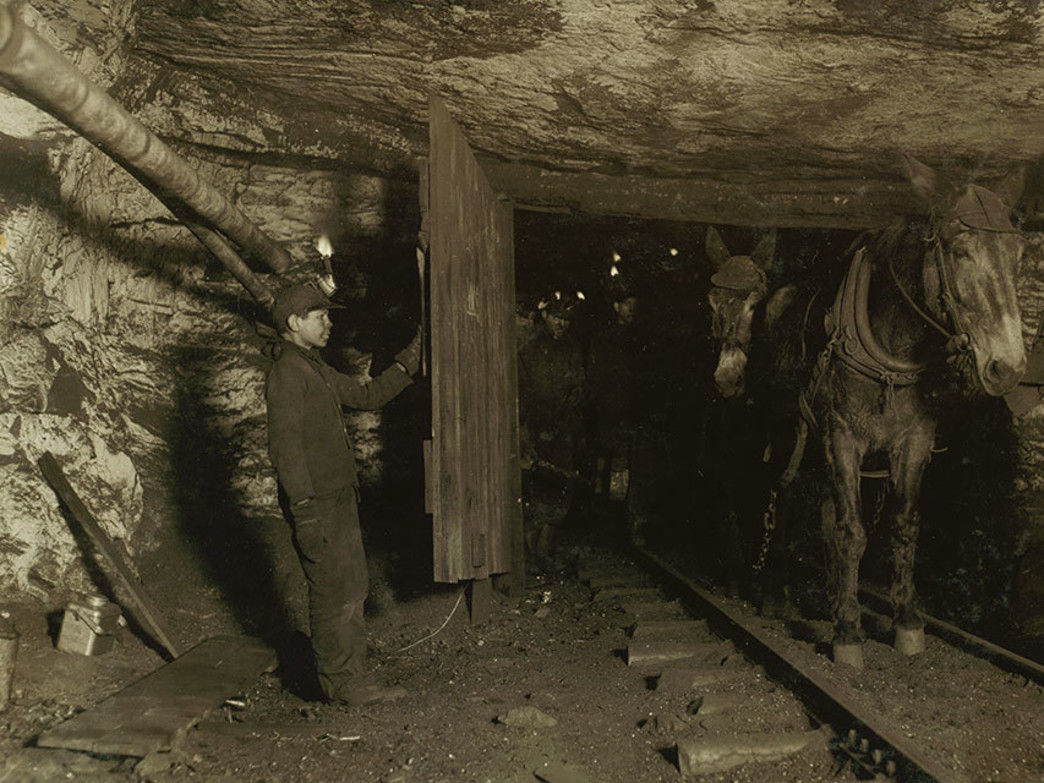 "A 13 year old ""trapper"" opens door in a mine in Pennsylvania, 1911."