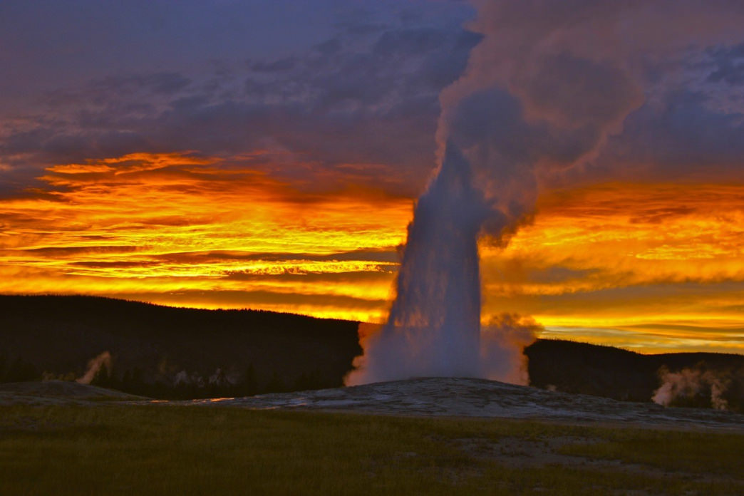 Old Faithful is one of the best places in the world to catch a sunset.     Douglas Scott