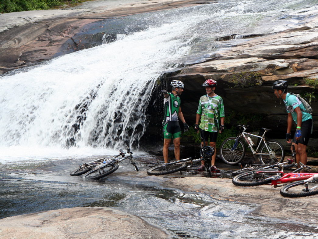 Cyclists cool off at the base of Bridal Veil Falls in DuPont Recreational Forest.