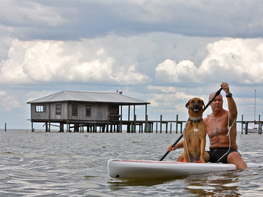 Dawson and his cave dog Eddie paddling near Gulf Shores
