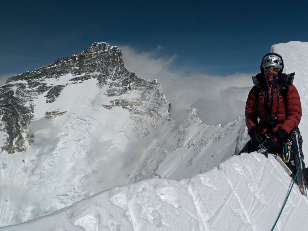 Kaltenbrunner straddles the summit ridge on Nupste, a 7861 meter peak in Nepal.