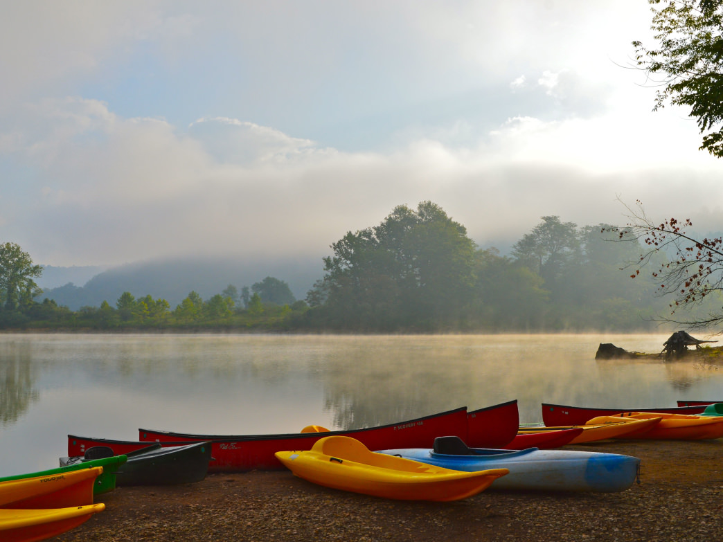 A crew of canoes at dawn.
