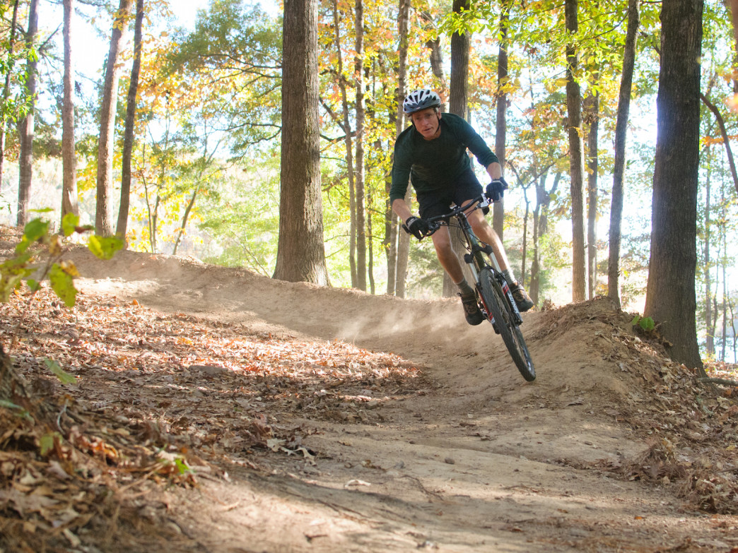 A mountain biker enjoys one of the CAMP-built trails at Chewacla State Park.
