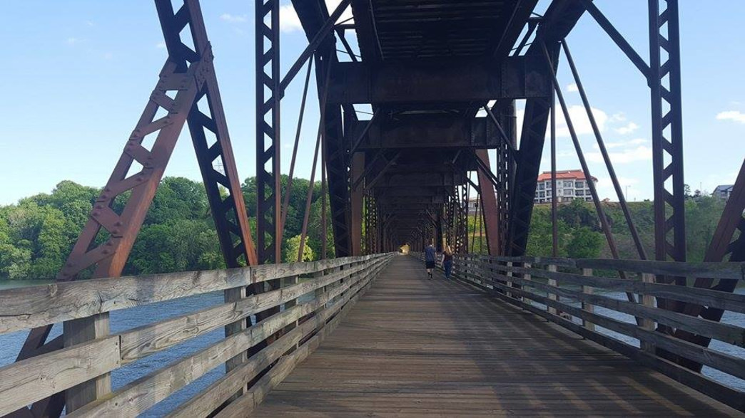The Old Railroad Bridge and Tennessee River provide a romantic backdrop for a date.