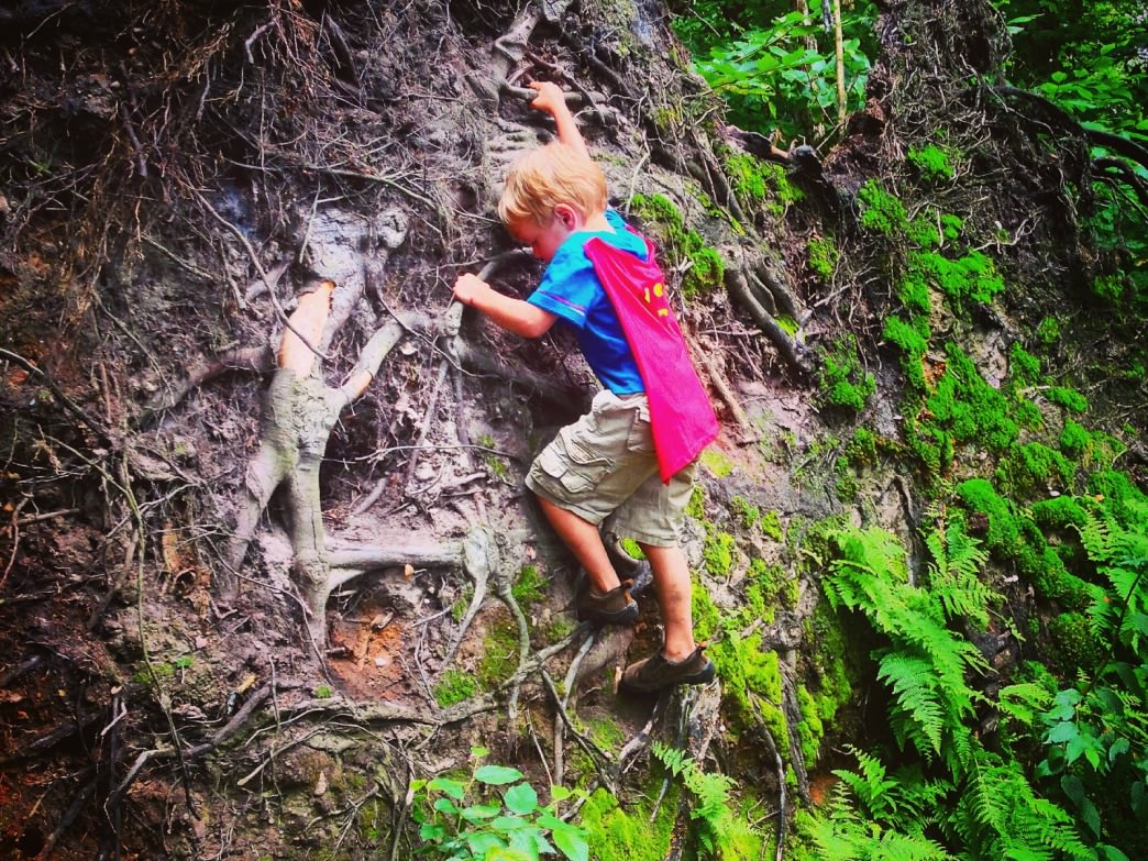 Climbing the root system of a fallen tree at the top of Duxbury Window.