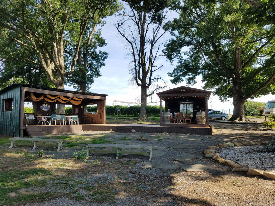 The outdoors space at Fiddler's Vineyard is a welcoming spot to sip some wine and while away a summer day.