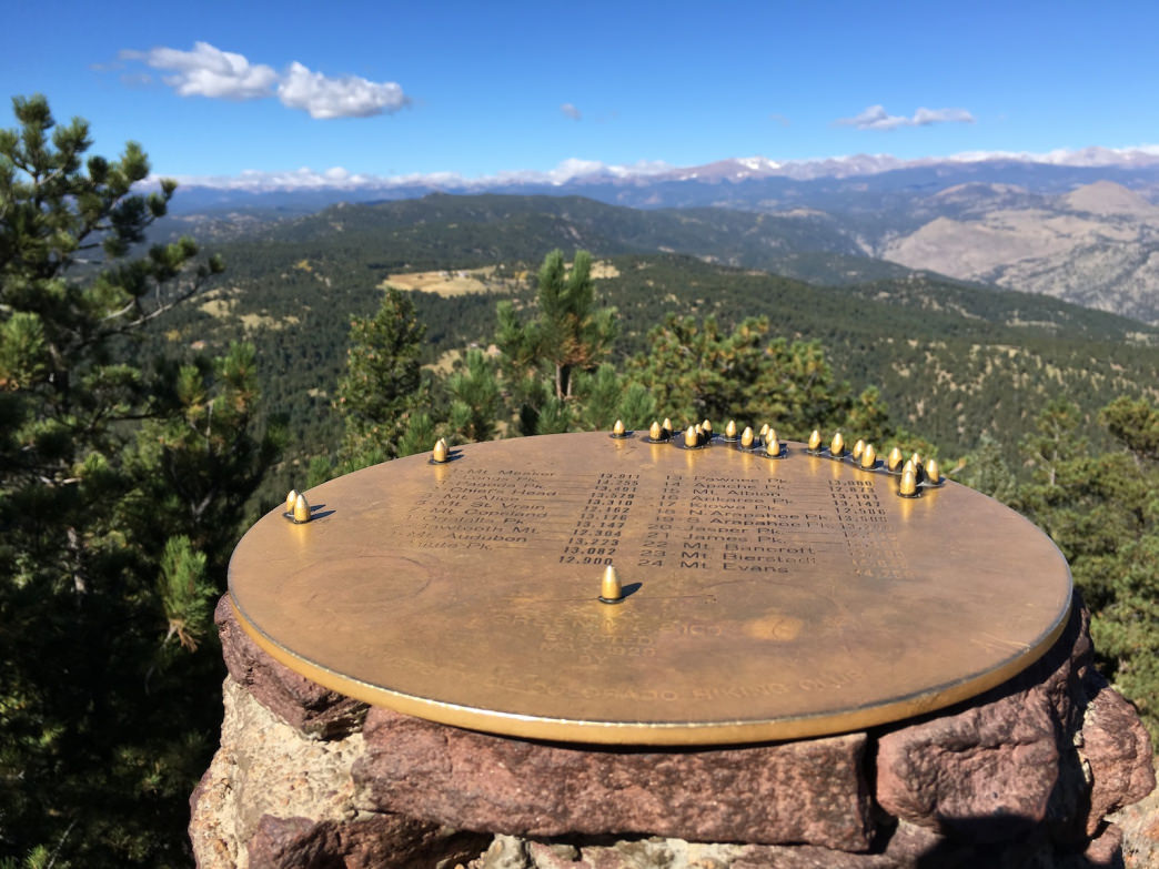 At the summit of Green Mountain, a plaque helps identify distant peaks.