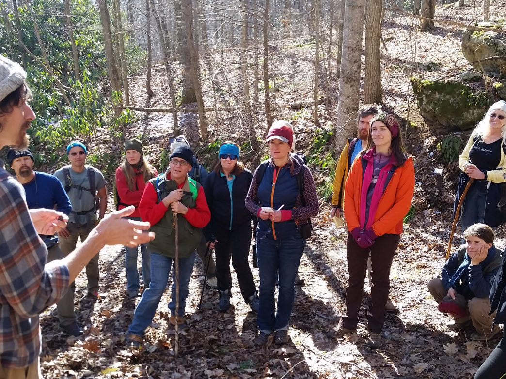 A naturalist with the Southern Appalachian Highlands Conservancy leads a winter tree identification workshop.