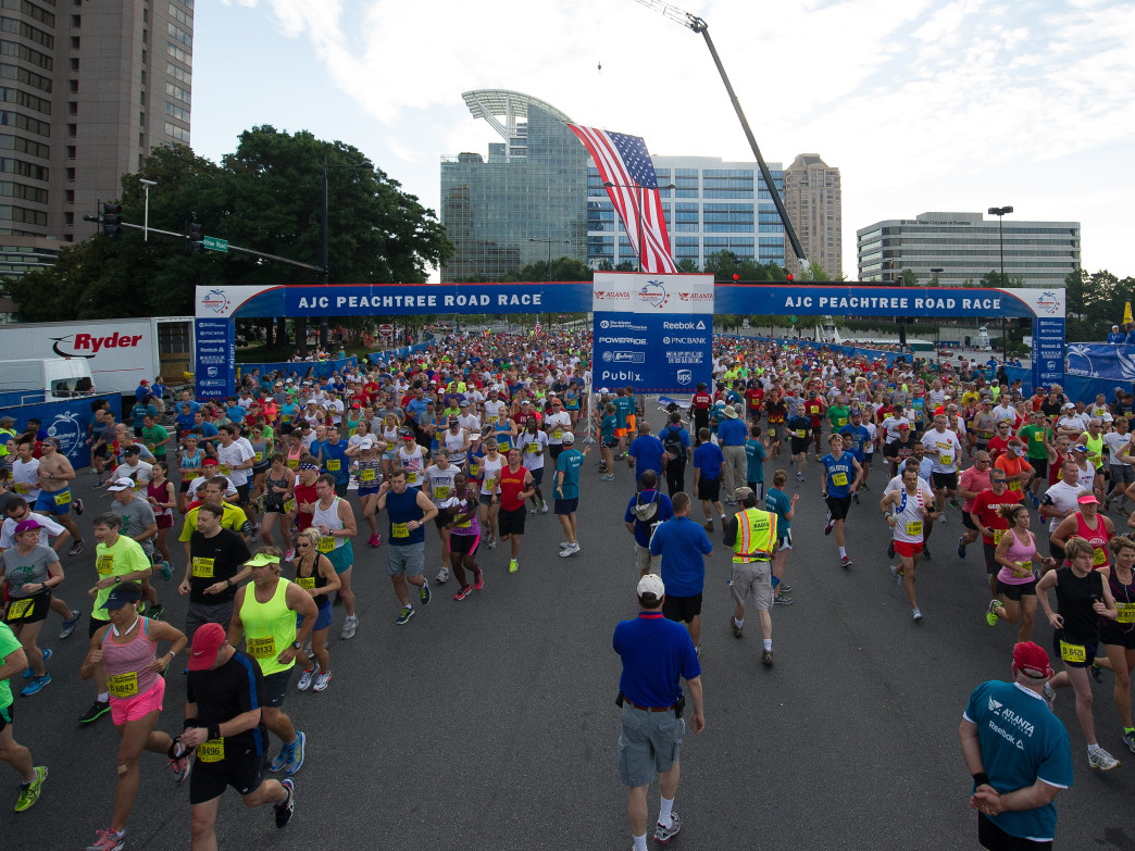Runners start the Peachtree Road Race