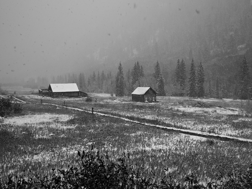A black-and-white image of Ashcroft during an autumn snow dusting evokes the mood of bygone eras.
