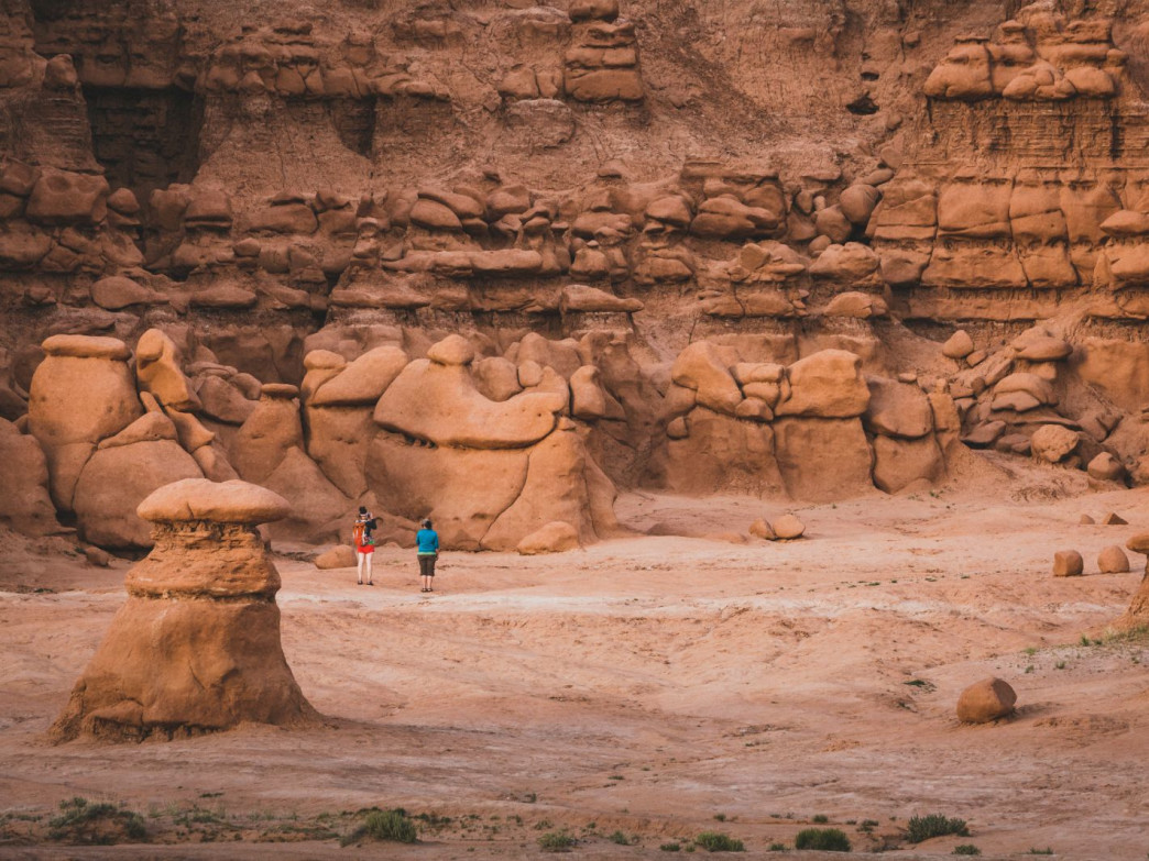 People wandering around the Valley of Goblins in Goblin Valley, Utah