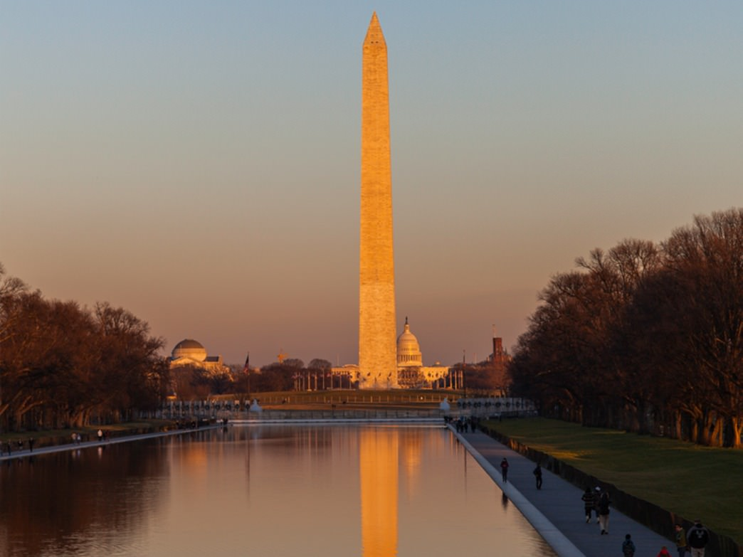 The Washington Monument towering over the Capitol Reflecting Pool taken during a sunset bike ride