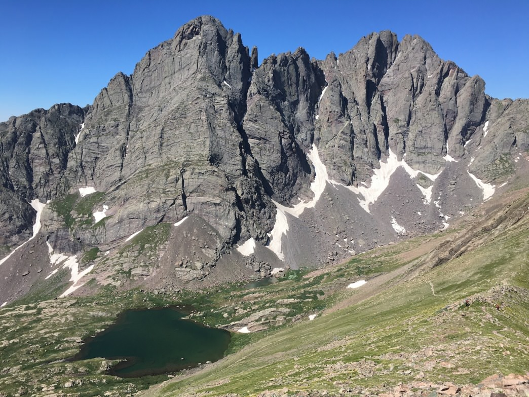 The Crestone Needle shows off its jagged spine from a towering overlook above Upper South Colony Lakes