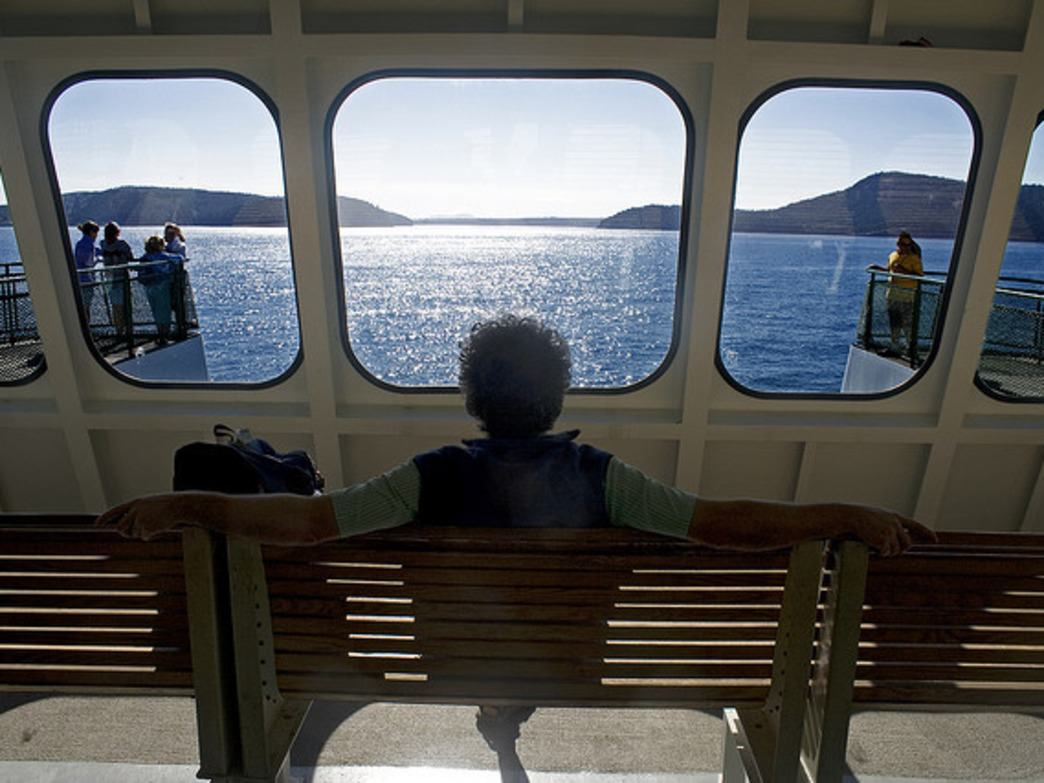 A woman sits back and enjoys the ride to San Juan Island.