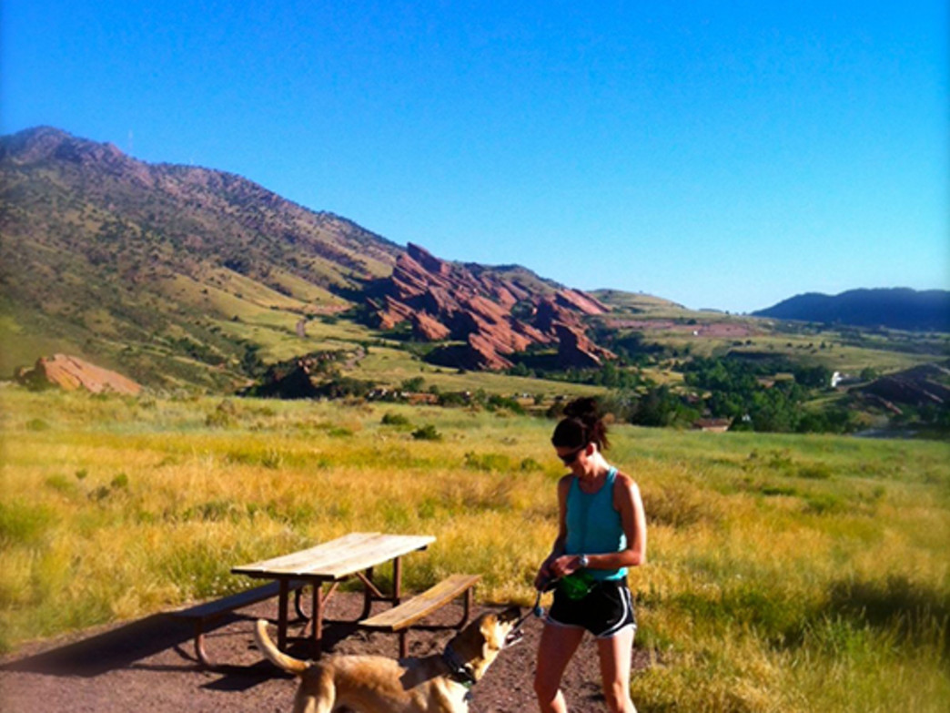 Cara on the trail with a canine pal!