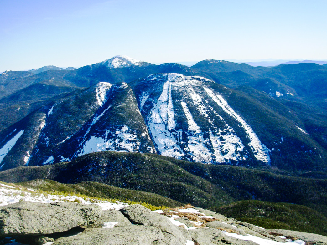 Algonquin offers great views down into Avalanche Pass and Mount Colden (foreground), as well as Marcy (background).