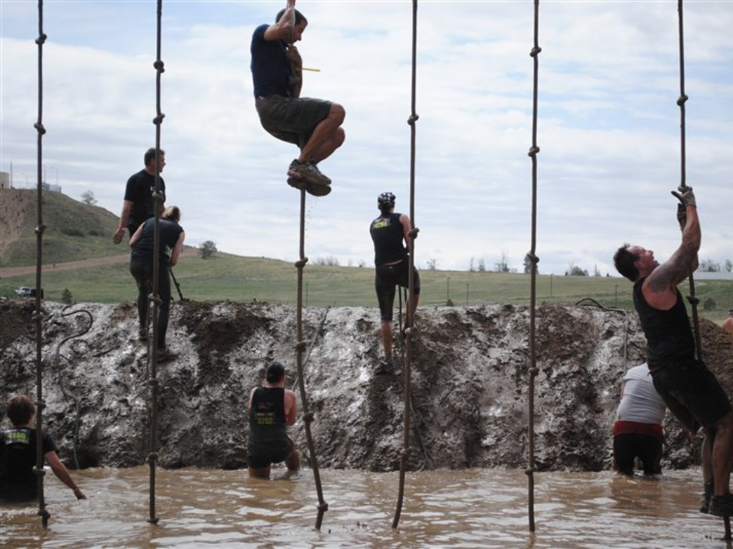 Whether or not you fall in to a mud pit by choice, there's no avoiding getting dirty at the Spartan Military Sprint.