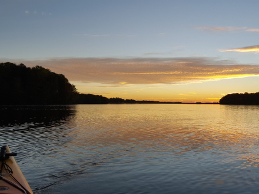 Although more populated than other area lakes, a paddler can still find a bit of solitude at sunset on Lake Norman.