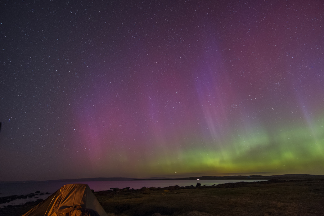 Camping beneath the Northern Lights in Scotland.