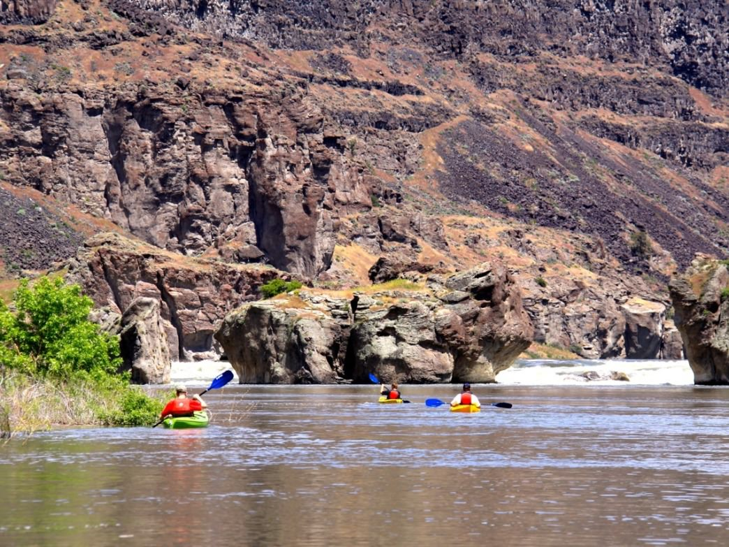 Paddlers in the Snake River Canyon near Twin Falls, Idaho, can paddle toward Pillar Falls and beyond for different views of the area.