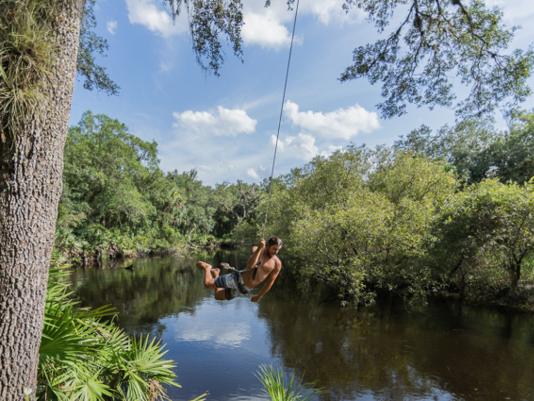 Swinging on a rope swing along the Econlockhatchee River
