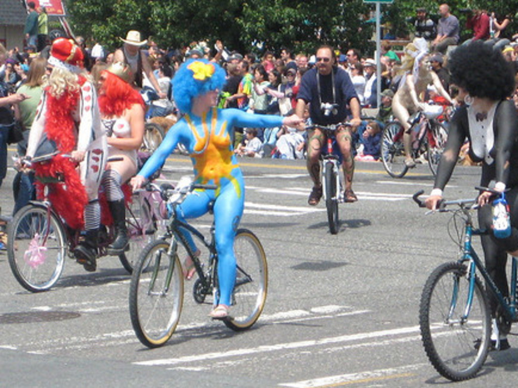 Body-painted bikers embrace the Fremont Solstice Parade.