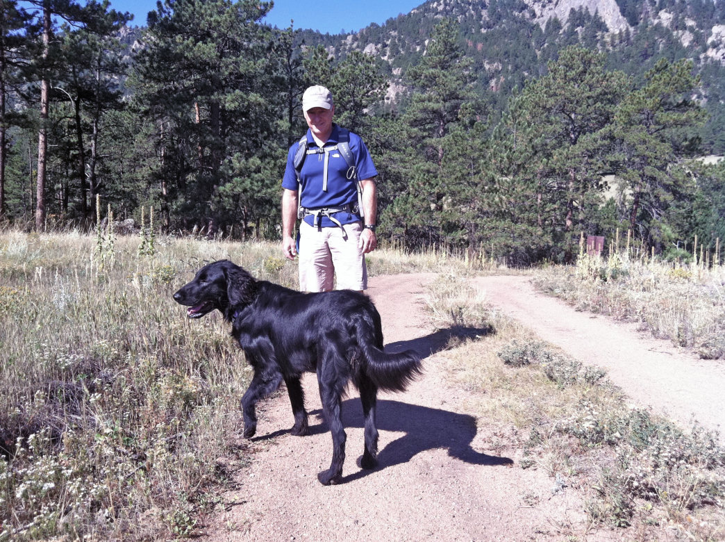 Cerretani hiking in Boulder with his dog Luna.     Courtesy of Nick Cerretani
