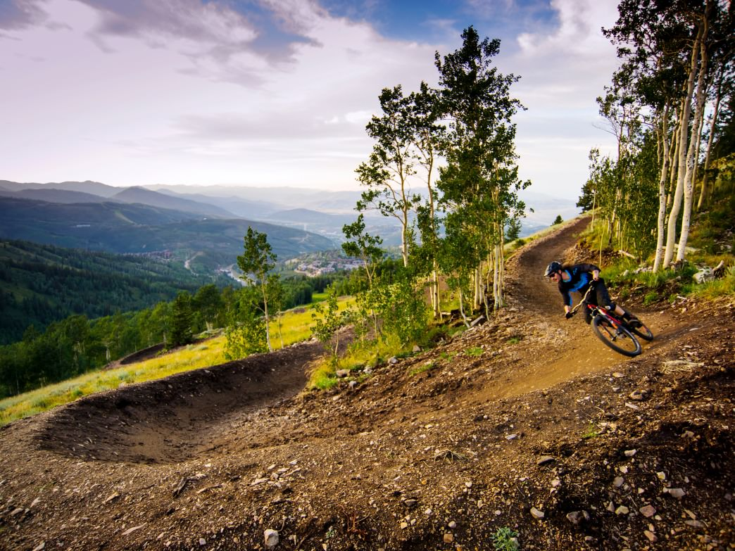 A biker descends one of Deer Valley's new flow trails. Deer Valley Resort