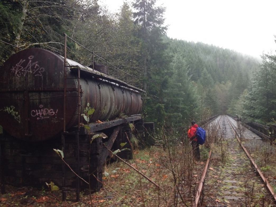 A rusted tank sits abandoned along the Salmonberry River trail.