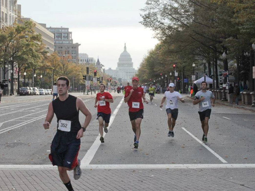 The Walk to End HIV turns into a run on Pennsylvania Avenue near the U.S. Capitol building.