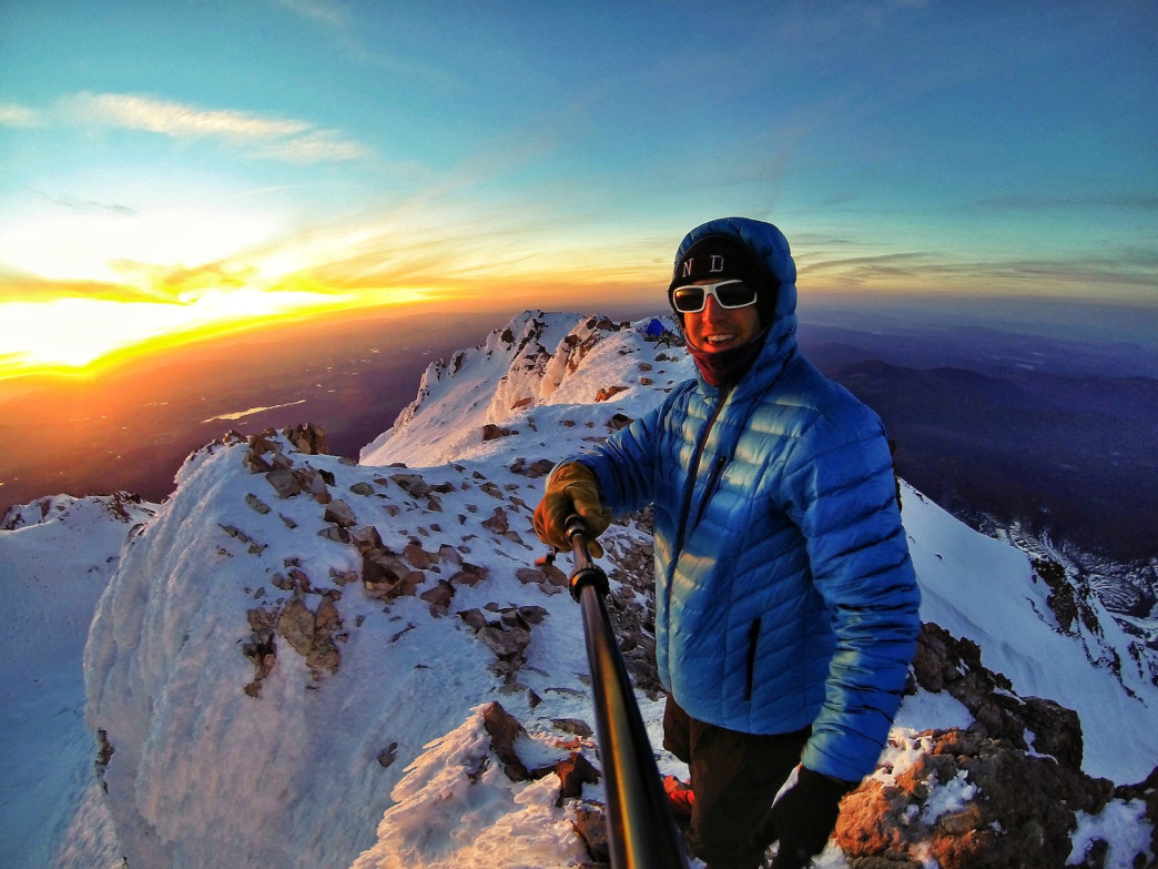 Capturing sunrises and sunsets from summits lights up Kedrowski. Here's a selfie he took on Mount Shasta in 2014.