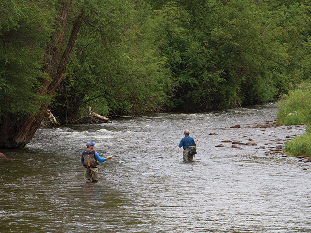 A pair of anglers wade across the gold medal waters of the Frying Pan River.