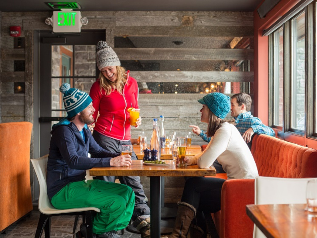 After a day on the slopes, stop by one of the many apres ski spots in Jackson such as the Spur in Teton Village (pictured).
