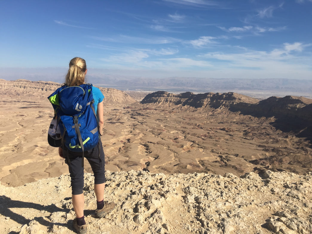 Hiking trails in the Negev Desert traverse giant craters created by erosion. Expect stout climbs and stunning views.