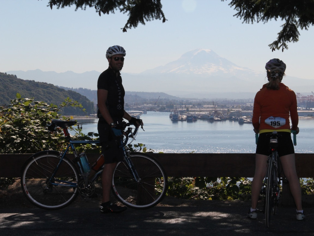 Cyclists take a breather to take in the views of Mount Rainier during Ride Around the Sound.