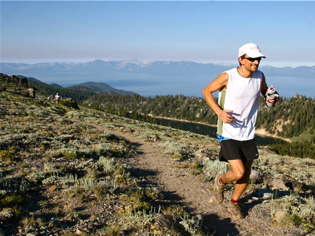 A runner traverses the ridge above Tahoe's Marlette Lake.