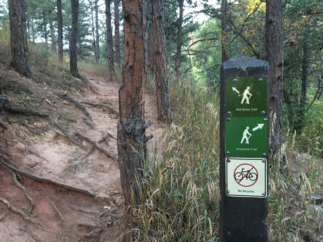 After crossing Sunshine Canyon Road to Centennial Trailhead, follow signs for the Red Rocks Trail.