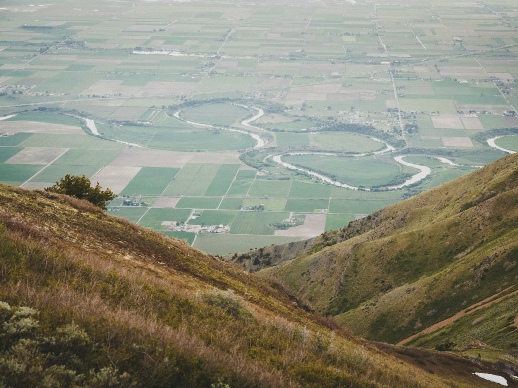 The oxbow bends of the Bear River near Honeyville, Utah seen from the Wellsville Mountains