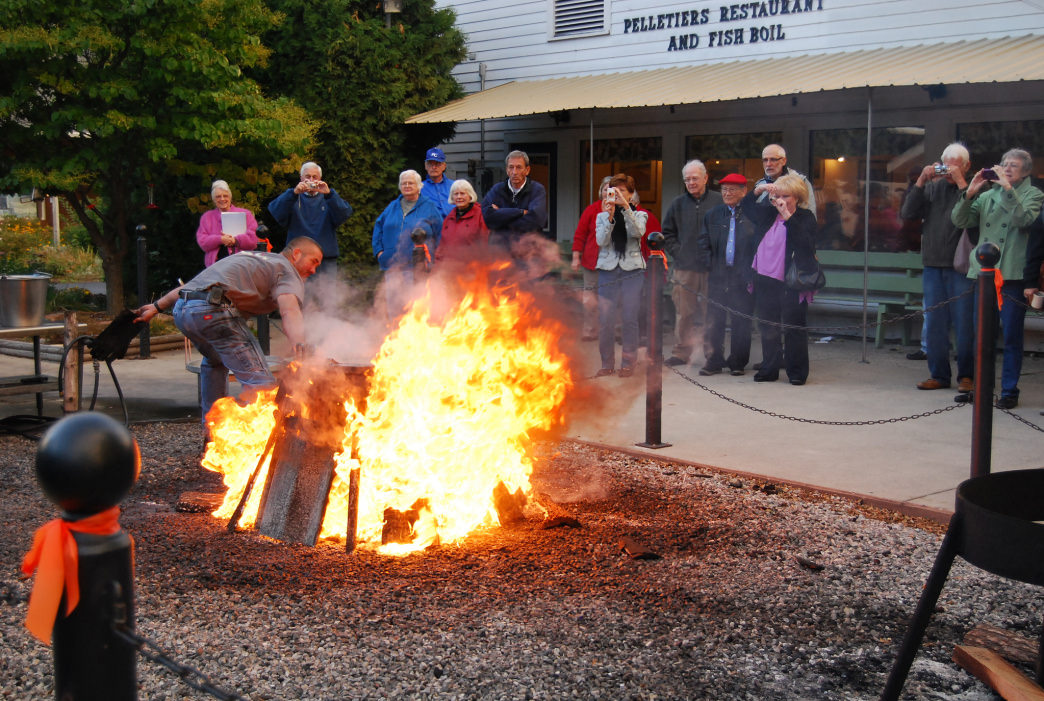 A Door County fish boil all starts with a blazing bonfire under a kettle of salted water.