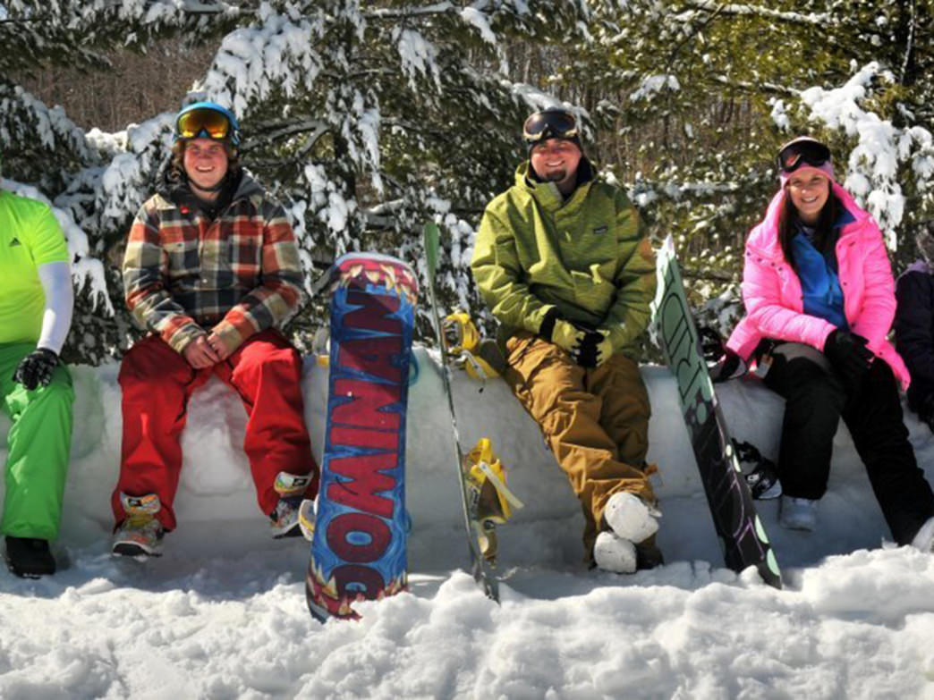 Taking a break from a day on the slopes, these Winterplace riders are nothing but smiles.