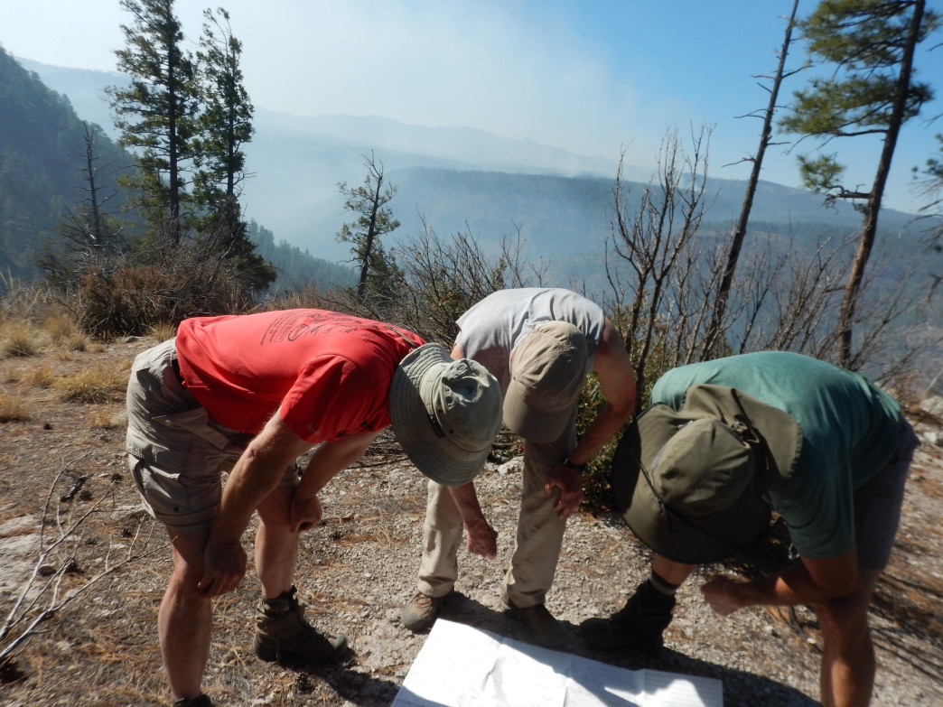 Studying the map after we encounter the wall of fire.