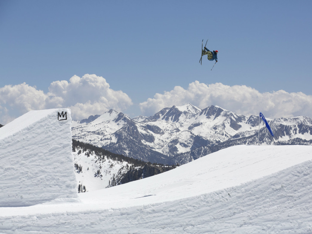 A skier in mid-flight on Mammoth Mountain.