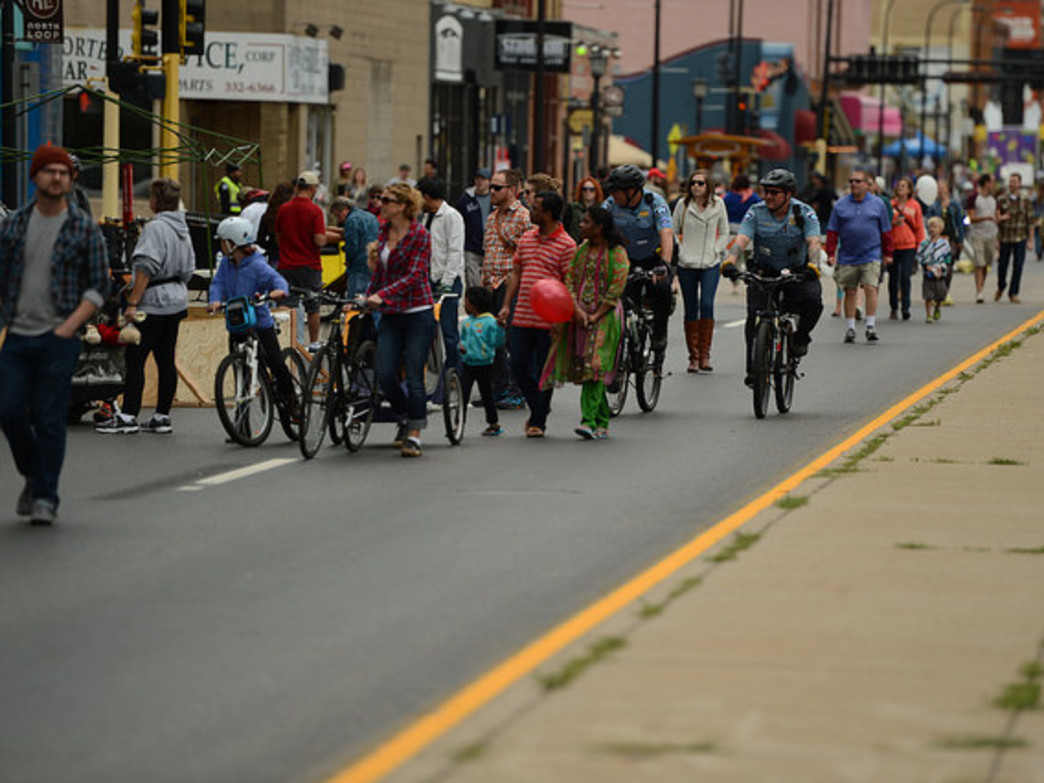 The Open Streets initiative shows how pedestrian and bike-friendly design can improve communities.