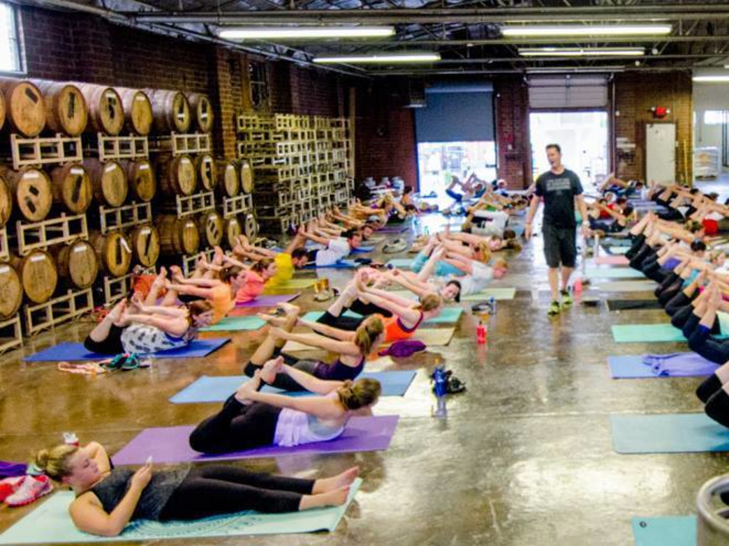 Yoga classes have become popular at several breweries across the city, including the Triple C.