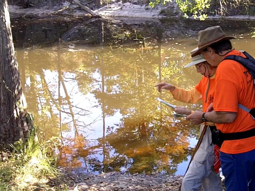 """Volunteers scope out the """"lay of the land"""" looking for the perfect route to build a new trail."""