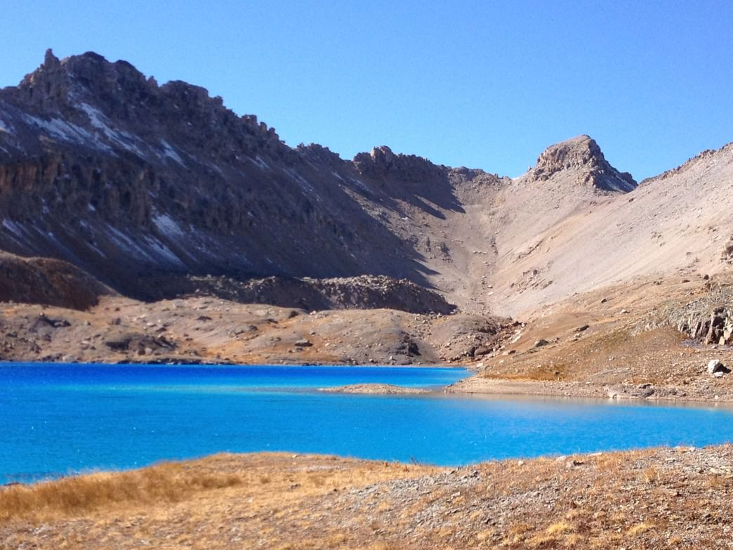The glistening jewel waters of Columbine Lake are a beautiful backdrop for a hike.