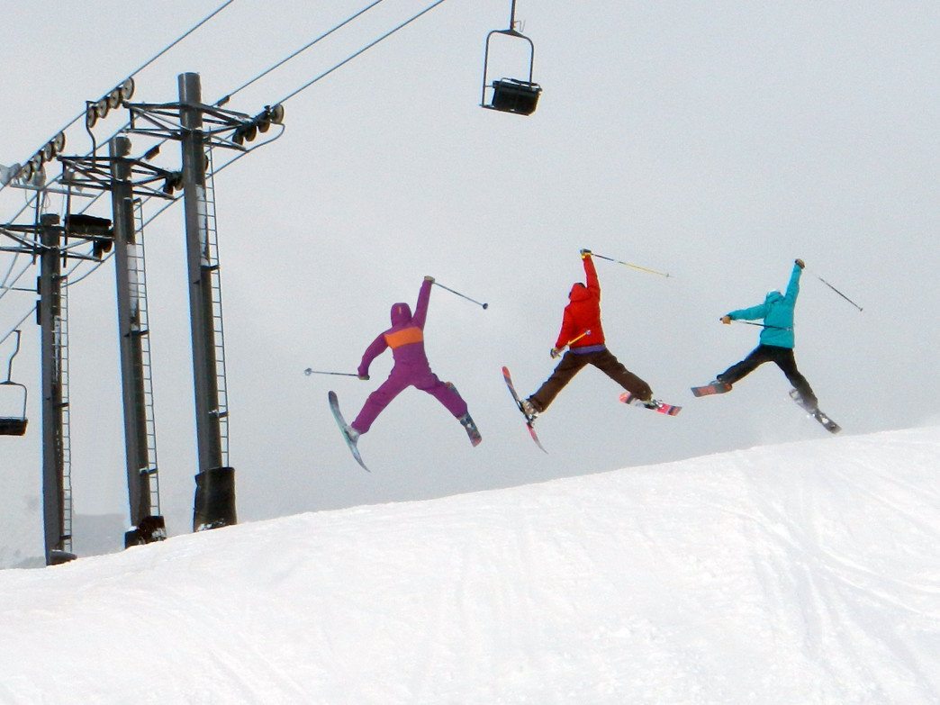 Mountain ladies demonstrate the fundamentals of joyful skiing.